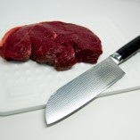7 Inch Santoku on board with meat